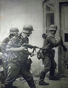 Wehrmacht troops storm a house in order to properly secure a Soviet city for occupation during the height of Operation Barbarossa.