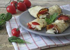 Deliziose fette di Melanzane che racchiudono squisiti pomodori e filante mozzarella, Involtini di Melanzane Pomodoro e Mozzarella, un contorno gustoso