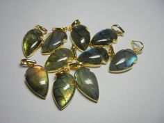 Labradorite Electroplated Gold Cabochon by GEMSTONEEXPORTERS