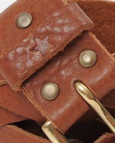 Handmade super soft veg tan leather belt. Comes in two colours, tan or black. The belts have star and rivet detail with a brass or chrome buckle.3cm wideS. 90cm  M. 95cm  L. 100cm