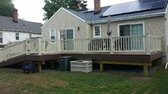 Sprawling custom deck, brown and tan two-tone. #customdeck allvinylfencing.net