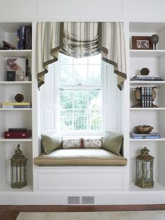 NOOK – Polished swags. This expertly tailored swag has jabots placed over the center scallop rather than behind it. The contrasting banding emphasizes its design.    Style tip: Placing fabric above a nook of any sort creates a warm and cozy space, much like a fabric canopy on a bed.