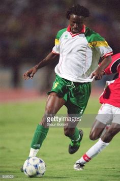Aliou Cisse of Senegal runs with the ball during the FIFA 2002 World Cup Qualifier against Egypt played in Cairo Egypt Egypt won the match 1 0...