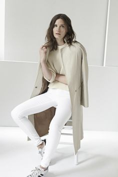 The Tokyo Sweater in Biscuit, the Trench Coat in Classic, and the Skinny Jean in White.