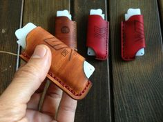 Creative Session Custom Lighter Holder. The lower opening is for beer opening. Simple solution.