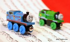 Turn on classical music. Play trains fast and slow to songs.