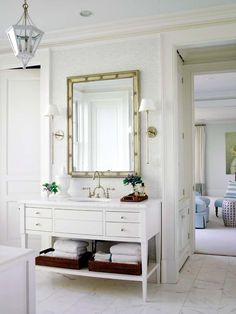 brick marble tile, open shelf vanity, and gooseneck faucet.