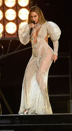 Wow factor: Beyonce looked absolutely stunning as always in a shiny white see-through gown...