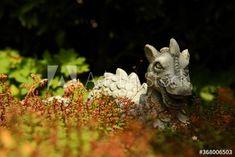 Stone dragon in garden behind sedum stonecrops – kaufen Sie dieses Foto und finden Sie ähnliche Bilder auf Adobe Stock | Adobe Stock Garden Sculpture, Dragon, Stone, Outdoor Decor, Photography, Animals, Image, Pictures, Rock