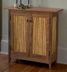Zebra Side Cabinet by Tom Dumke. The expert craftsmanship and Shaker-inspired design of this cabinet accentuate the stunning natural grain of walnut and zebrawood. Mortise & tenon joinery and pegged construction ensure that the piece is as well built as it is beautiful. Two adjustable shelves inside. Lacquer finish.