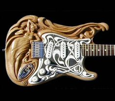 Art Nouveau    This guitar is carved by Doug Rowell, a sculptor/wood carver, who has been carving wood for over 40 years. Amazing work, just look at this guitar...o_o  (http://www.carverdoug.com)