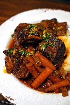 These Braised Short Ribs with Citrus Gremolata is a way to impress and wake up the taste buds. The bright citrus, garlic and parsley mixture with each fork tender braised short rib bite will soon become a house favorite.