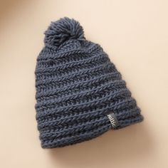 HORIZONTAL HAT -- Horizontally knit in warm wool, fleece-lined and topped with a pompon. Imported. One size fits most.