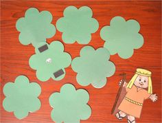 In this game, the children have to see if they can find the one lost sheep. I made several bushes (more than pictured here) and put magnets on the back of each one so I could use this game on our large magnetic whiteboard. A cookie sheet could be used just as well. I put a sticker of a sheep on the back of only one of the bushes. The children take turns turning over a bush until someone finally finds the one lost sheep.