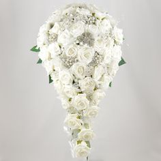 This white rose brides teardrop bouquet is made with quality artificial roses and finished with crystal stems, pearl stems, organza ribbon,