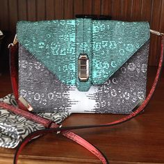 """Rebecca Minkoff Crossbody Purse (Host Pick) Details: Rare bag! Gorgeous tri-colored black, turquoise, and orange/red shades on silver snake-skin look background with front turn lock hardware.  Dimensions: 11 X 8""""; detachable strap is 41"""" with a small belt buckle Has dust bag In new condition Rebecca Minkoff Bags Crossbody Bags"""