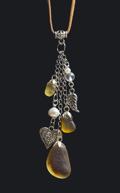 Boho necklace with amber and multicolored sea glass, freshwater pearls, frosted glass and silver plated charms. Check out my website: fionnabottema.com #seaglassnecklace #fakeseaglass #seaglassearrings