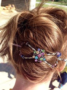 Add gorgeous colorful sparkle to your hair updo with Rainbow Cluster flexi clip. Pink, green, yellow, and blue shine bright in a tails up French twist style.