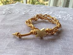 Double wrap bracelet in gold leather wrap by PatriciaEnterprises, $28.00
