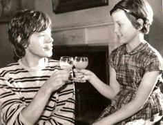 Mick jagger shares his birthday with a young fan. Rocks bad boy behaving for a half a second. Cute!