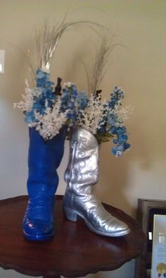Centerpiece from our retirement party.  I did one boot per table with a blue cloth and silver runner.  Texas with an Air Force twist.
