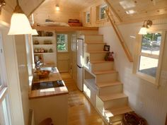 Living Area - Ynez by Oregon Cottage Company: Love the closet space & hidden washer/dryer combo. Great that there's space for oven under the stairs. Needs sunroof, french doors, & sink in bath.