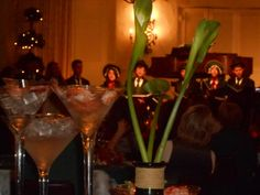 Ice, shrimp, cala lilies and carolers at christmas holiday