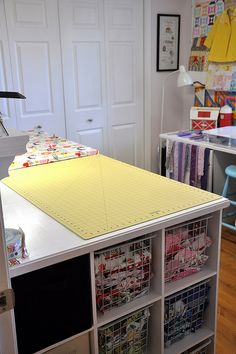 Great cutting table with cubbies for scraps. Beautiful sewing space at pleasant-home blog!