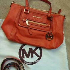 """MICHAEL KORS Gilmore Tangerine Satchel This bag has been carried and is in very good condition. It has 6.5"""" double handles and 24"""" adjustable/ detachable shoulder strap. Top Zip closure . Exterior have zip pocket and back slip pocket. Interior have zip pocket , 4 slip pockets and key fob. Michael Kors Bags Satchels"""