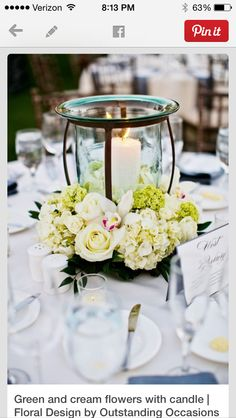 Centerpieces. Love the glass candle holder.