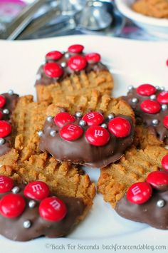 3 Ingredient Chewy Peanut Butter Chocolate Dipped and topped with M&M cookies!