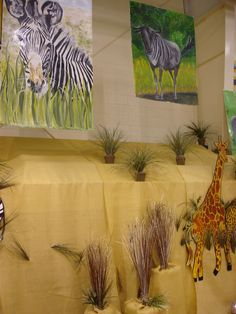 A safari-inspired school auction used canvas to cover the bleachers.  Plants and painted wall hangings finished the look.