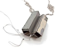 Demi Thomloudis Necklace: Kinetic Fragments 2013 Cement, sterling silver, nickel silver, resin, pigment, fiber