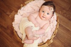 5-month-old baby girl with beautiful eyes posed in a basket, unique fine art baby photos by Olga Klofac Professional Baby & Child Photographer Charlestown Mayo  www.mayophotographer.ie