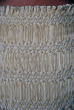 Beads on smocking--give 'bling'.