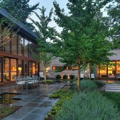 I like the use of square pavers and yet the spaces don't feel square. Perfect combination of landscaping and hardscaping