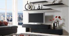 I like the floating shelves over the tv