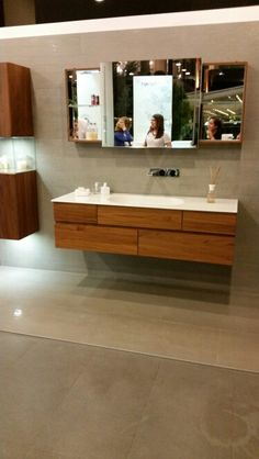 Vitra memoria unit in chestnut with mirror with sliding door designed by christophe pillet