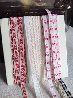 A personal favourite from my Etsy shop https://www.etsy.com/uk/listing/466072623/vintage-tape-trims-red-white-tapes