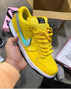 Over the past few weeks, Nicky Diamonds of Diamond Supply Co., has been teasing multiple colorways of his upcoming project with Nike SB. Best Sneakers, Sneakers Nike, Burberry Purse, Yellow Nikes, Dunk Low, Nike Sb Dunks, Diamond Supply Co, Hip Hop Outfits, Prada Bag
