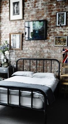 Brick Wall In a Rustic Bedroom — Interior Design.