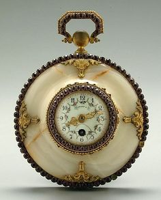 Antique jeweled Tiffany clock (via AntiqueClockPrices)