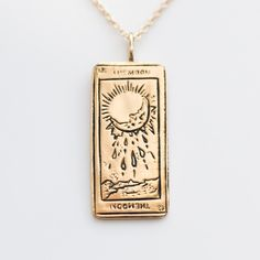 According to the designer, Sofia Zakia, The Moon encourages celestial dreams and awakens a spiritual intuition in your life journey. Made by hand in Montreal Solid gold Each card measures x and is made of solid gold solid gold mm cable chain Cute Jewelry, Jewelry Box, Jewelery, Jewelry Accessories, Weird Jewelry, The Sun Tarot Card, The Moon Tarot, Tarot Card Tattoo, Accesorios Casual