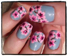 Cherry Blossoms... these look like what sites drew for me so yep want the design on my nails