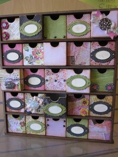 Drawer set made by one of the people from Scrapadoodle in Peoria.  It started as plain chipboard drawers.