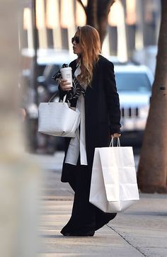 Pin for Later: 84 Styling Hacks We Learned From Mary-Kate and Ashley Olsen Long Coats With Pooling Pants Are a Game Changer Ashley Olsen in New York City in Ashley Olsen Style, Olsen Twins Style, Mary Kate Ashley, Mary Kate Olsen, Carrie Bradshaw, Olsen Fashion, Olsen Sister, Yves Saint Laurent, Victoria Beckham Style