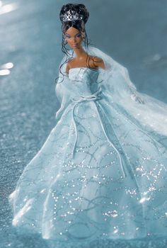 "Barbie® Doll 2001 | Release Date: 6/1/2001...Second in a series that celebrates the first decade of the new millennium, Barbie® doll looks magnificent in a dazzling organza gown and ""2001"" tiara."