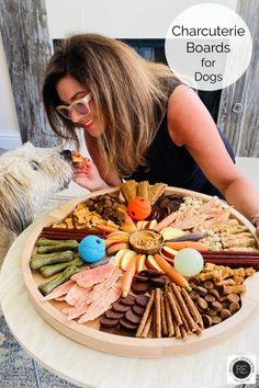 Charcuterie Boards for Dogs, or barkuterie or chowcuterie, are filled with dog treats, biscuits, peanut butter and dog-friendly human food. #charcuterieboardsfordogs #charcuteriefordogs #dogcharcuterie #barkuterie #chowcuterie #reluctantentertainer
