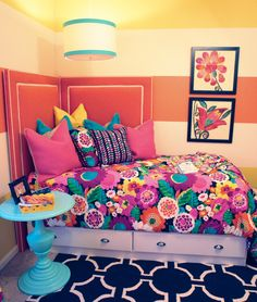 Obsessed with the corner headboard. And the colors.. haha SO looks like my house