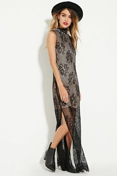 This sleeveless maxi dress by The Allflower™ is crafted from a sheer eyelash floral lace with contrast lining, side slits, and a mock neck. .
